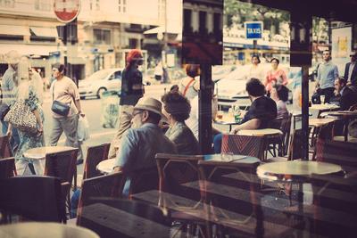 Old couple enjoying coffe